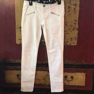 Zip skinny white jeans.